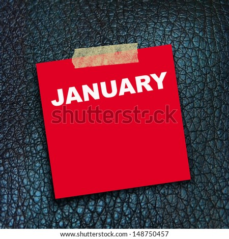 text January  on red  short note paper on sneck skin texture background #148750457
