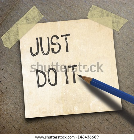 text just do it and black pencil and  shortnote paper on the packing paper box texture background