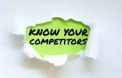 Text know your competitors appearing behind torn paper.