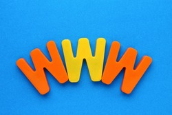 Text made in multicolored magnetic letters. WWW. Blue background