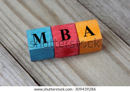 text MBA ( Master of Business Administration) on colorful wooden