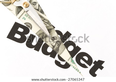 text of Budget and scissors, concept of Budget cut - stock photo