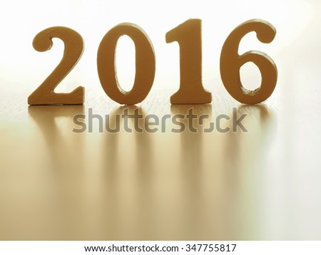 Text of gold 2016, make from wood. Golden year 2016. New year decoration, closeup on 2016 text. Happy new year 2016. Gold 2016 on wood floor with copy space at the bottom for your text.