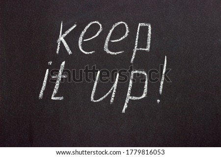 Text on a dark board 'keep it up'. Encouraging and motivating lettering Foto d'archivio ©