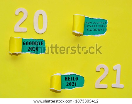 Text on colorful torn paper with Year 2021 background. New journey starts with goodbye, goodbye 2020 and hello 2021. Happy New Year Concept