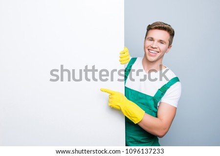 Text people sheet place billboard attention look tips people personnel hotel dust purity white wall face peep person concept. Glad polite kind man suggesting to use isolated on gray background