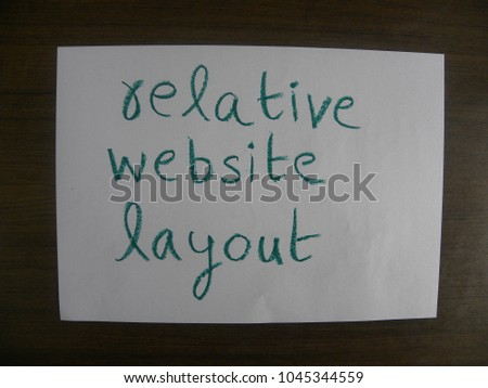 Text relative website layout hand written by green oil pastel on white color paper #1045344559