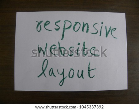 Text responsive website layout hand written by green oil pastel on white color paper #1045337392