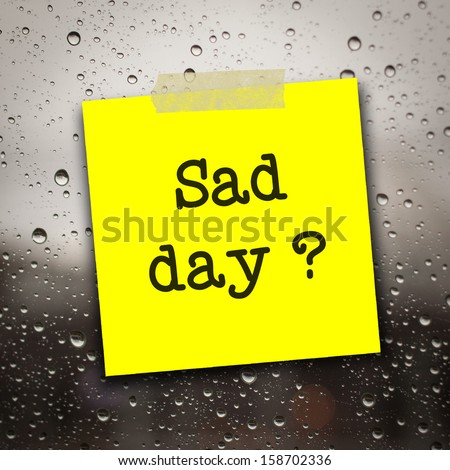 text sad day on the short note on the  rain drop on the mirror background
