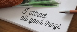Text showing I Attract All Good Things and 100 Euro banknotes Positive attraction law Motivation Affirmation Concept.