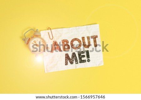 Text sign showing About Me. Conceptual photo telling someone list of your good and bad traits and past events Metal alarm clock clip blank crushed note sheet colored background.