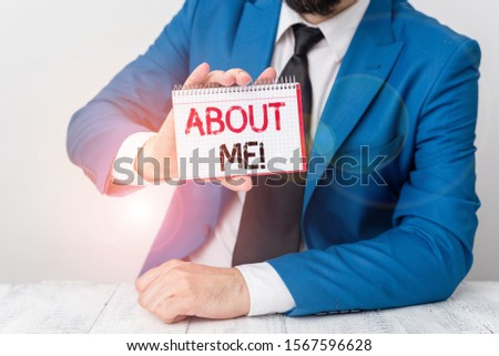 Text sign showing About Me. Conceptual photo telling someone list of your good and bad traits and past events Man holds empty paper with copy space in front of him Copy Space.