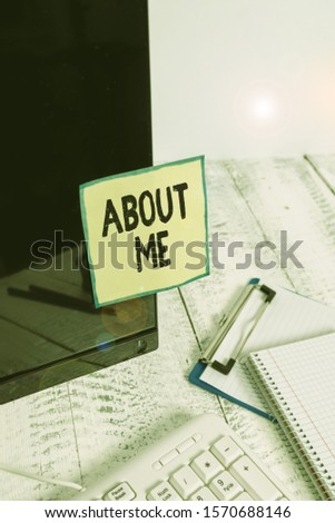 Text sign showing About Me. Conceptual photo telling someone list of your good and bad traits and past events Note paper taped to black computer screen near keyboard and stationary.