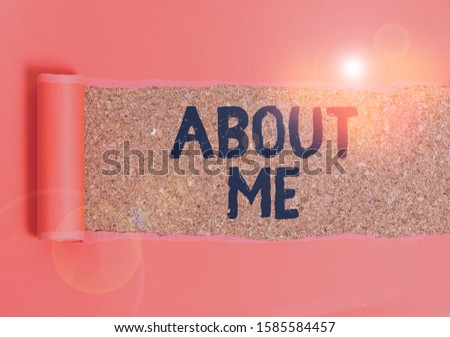 Text sign showing About Me. Conceptual photo telling someone list of your good and bad traits and past events Cardboard which is torn in the middle placed above a wooden classic table.