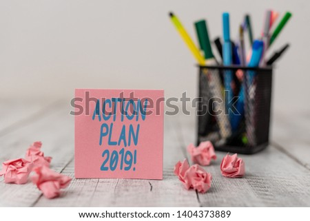 Text sign showing Action Plan 2019. Conceptual photo proposed strategy or course of actions for current year Set of plain note paper with scraps and stationary on the wooden table. #1404373889