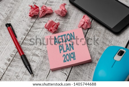 Text sign showing Action Plan 2019. Conceptual photo proposed strategy or course of actions for current year Writing equipment and paper plus scraps with gadgets on the wooden desk. #1405744688