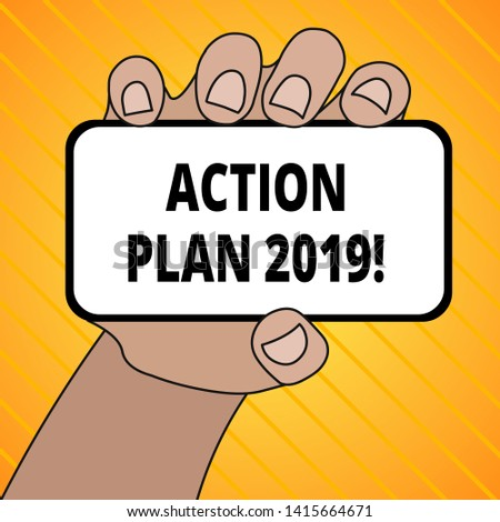 Text sign showing Action Plan 2019. Conceptual photo proposed strategy or course of actions for current year Closeup of Smartphone Device Held in Hand with Blank Screen and Text Space.
