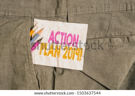 Text sign showing Action Plan 2019. Conceptual photo proposed strategy or course of actions for current year Writing equipment and white note paper inside pocket of man work trousers.