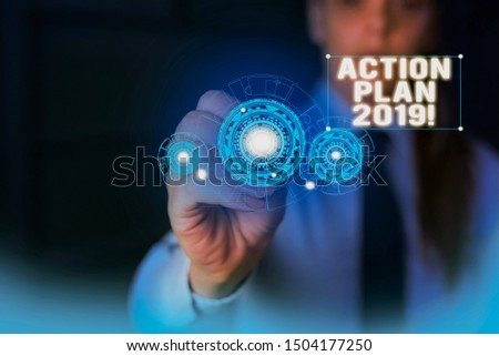 Text sign showing Action Plan 2019. Conceptual photo proposed strategy or course of actions for current year Woman wear formal work suit presenting presentation using smart device.