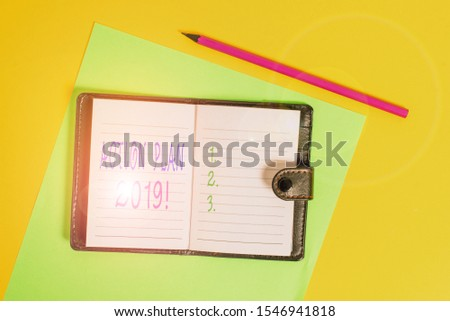 Text sign showing Action Plan 2019. Conceptual photo proposed strategy or course of actions for current year Dark leather private locked diary striped sheets marker colored background. #1546941818