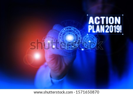 Text sign showing Action Plan 2019. Conceptual photo proposed strategy or course of actions for current year Woman wear formal work suit presenting presentation using smart device. #1571650870