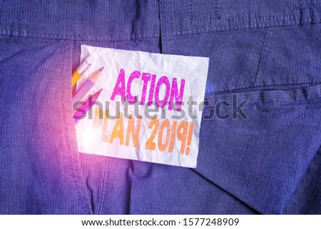 Text sign showing Action Plan 2019. Conceptual photo proposed strategy or course of actions for current year Writing equipment and white note paper inside pocket of man work trousers. #1577248909