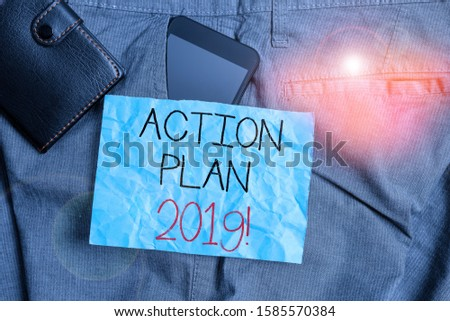 Text sign showing Action Plan 2019. Conceptual photo proposed strategy or course of actions for current year Smartphone device inside trousers front pocket with wallet and note paper.