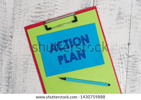 Text sign showing Action Plan. Conceptual photo proposed strategy or course of actions for certain time Colored clipboard blank paper sheet marker sticky note wooden background. #1430759888