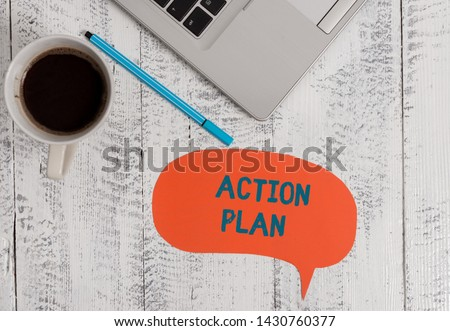Text sign showing Action Plan. Conceptual photo proposed strategy or course of actions for certain time Metallic open laptop speech bubble coffee cup ballpoint pen vintage table. #1430760377