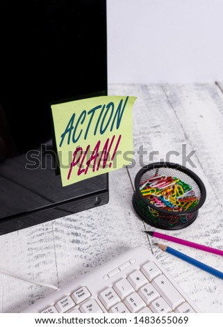 Text sign showing Action Plan. Conceptual photo proposed strategy or course of actions for certain time Note paper taped to black computer screen near keyboard and stationary.