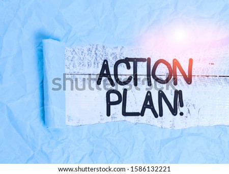 Text sign showing Action Plan. Conceptual photo proposed strategy or course of actions for certain time Cardboard which is torn in the middle placed above a wooden classic table.