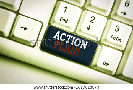 Text sign showing Action Plan. Conceptual photo proposed strategy or course of actions for certain time White pc keyboard with empty note paper above white background key copy space.