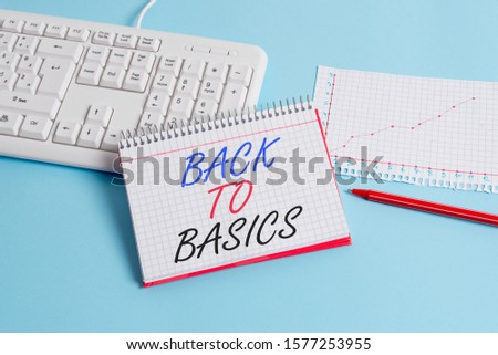 Text sign showing Back To Basics. Conceptual photo Return simple things Fundamental Essential Primary basis Paper blue desk computer keyboard office study notebook chart numbers memo.