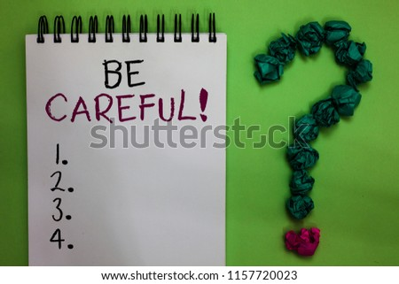 Text sign showing Be Careful. Conceptual photo making sure of avoiding potential danger mishap or harm Open notebook crumpled papers forming question mark green background. #1157720023
