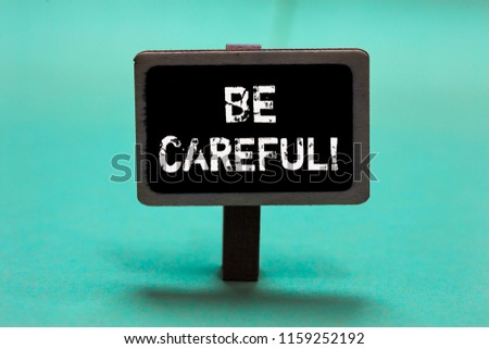 Text sign showing Be Careful. Conceptual photo making sure of avoiding potential danger mishap or harm Blackboard green background important message ideas communicate reflections. #1159252192