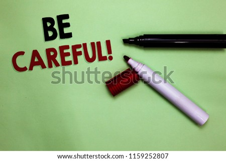Text sign showing Be Careful. Conceptual photo making sure of avoiding potential danger mishap or harm Open markers Inspiration communicating ideas messages green background. #1159252807