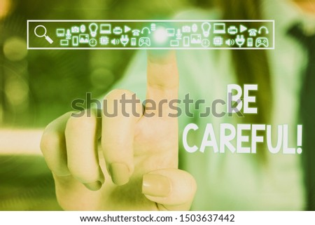 Text sign showing Be Careful. Conceptual photo making sure of avoiding potential danger mishap or harm Woman wear formal work suit presenting presentation using smart device. #1503637442
