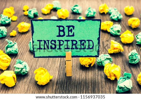 Text sign showing Be Inspired. Conceptual photo extraordinary quality as arising from some creative impulse Clothespin holding green note paper crumpled papers several tries mistakes. #1156937035