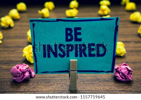 Text sign showing Be Inspired. Conceptual photo extraordinary quality as arising from some creative impulse Clothespin holding blue paper note crumpled papers several tries mistakes. #1157719645