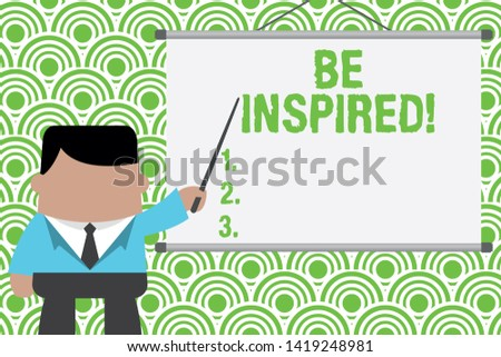Text sign showing Be Inspired. Conceptual photo fill someone with urge or ability to do or feel something Businessman standing in front projector screen pointing project idea.