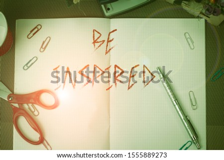 Text sign showing Be Inspired. Conceptual photo give oneself the desire or enthusiasm to do something well Scissors and writing equipments plus math book above textured backdrop.
