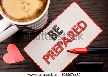 Text sign showing Be Prepared. Conceptual photo Preparedness Challenge Opportunity Prepare Plan Management written on Sticky Note on the wooden background Coffee Cup Heart Marker next to it. #1065676682