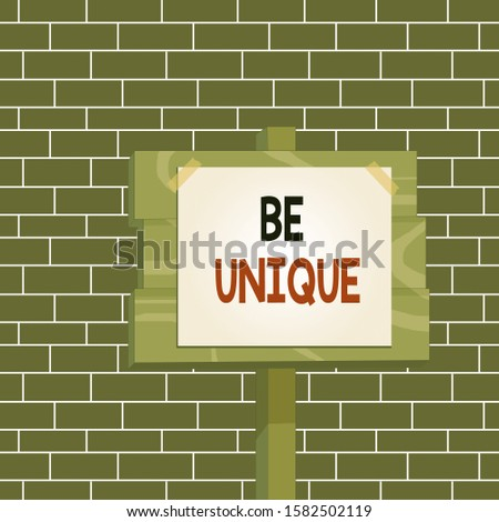 Text sign showing Be Unique. Conceptual photo being the only one of its kind Unlike anything else Incomparable Wood plank wooden stick pole paper note attached adhesive tape empty space.