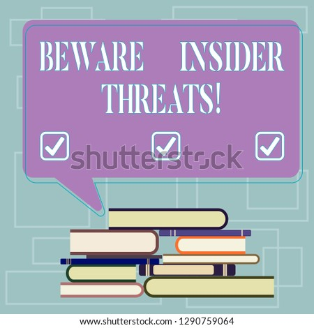 Text sign showing Beware Insider Threats. Conceptual photo Be cautious on malicious attack inside the network Uneven Pile of Hardbound Books and Blank Rectangular Color Speech Bubble.