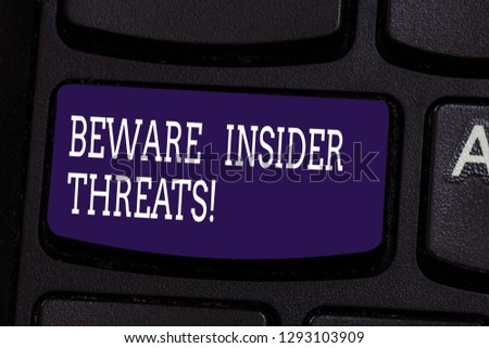 Text sign showing Beware Insider Threats. Conceptual photo Be cautious on malicious attack inside the network Keyboard key Intention to create computer message pressing keypad idea. #1293103909