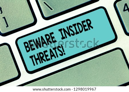 Text sign showing Beware Insider Threats. Conceptual photo Be cautious on malicious attack inside the network Keyboard key Intention to create computer message pressing keypad idea. #1298019967