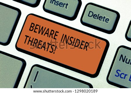 Text sign showing Beware Insider Threats. Conceptual photo Be cautious on malicious attack inside the network Keyboard key Intention to create computer message pressing keypad idea. #1298020189