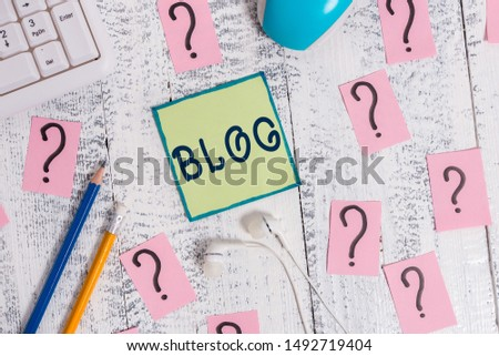 Text sign showing Blogquestion. Conceptual photo regularly updated website web page run by individual Writing tools, computer stuff and scribbled paper on top of wooden table.