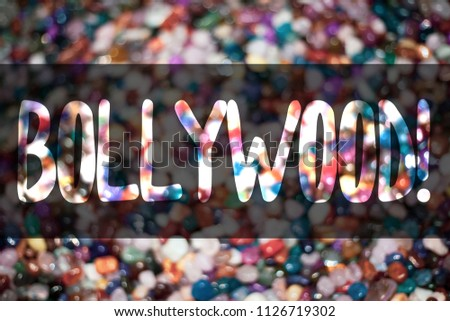 Text sign showing Bollywood Motivational Call. Conceptual photo Hollywood Movie Film Entertainment Cinema Blurry candies candy ideas message reflection sweets thoughts communicate. #1126719302