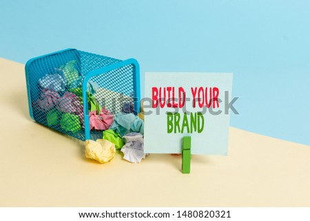 Text sign showing Build Your Brand. Conceptual photo enhancing brand equity using advertising campaigns Trash bin crumpled paper clothespin empty reminder office supplies tipped.